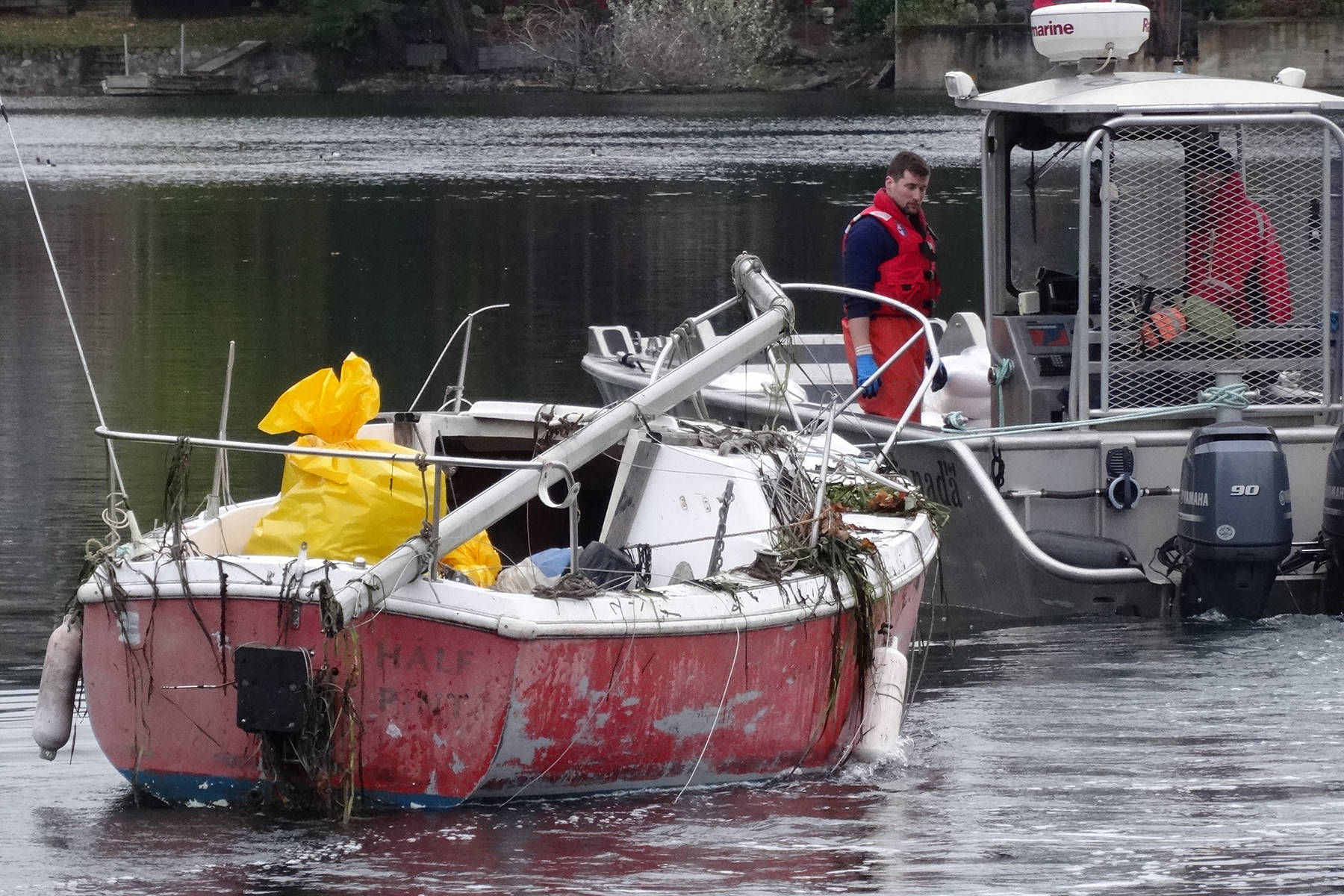 Coast Guard float a previously sunken boat in the Gorge Waterway near the Victoria Canoe and Kayak Club in Saanich. (Submitted photo)