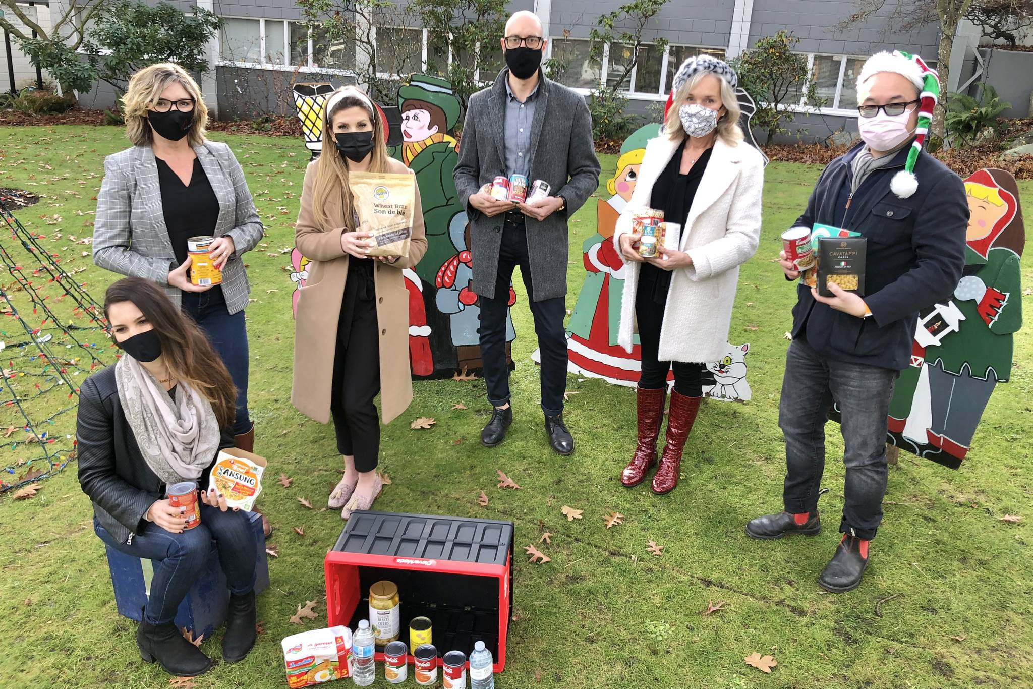 Oak Bay Village real estate agents ready to compete in the annual Realtor Food Bank Challenge, from left, Nancy Stratton and Emily Moyes from The Agency, Mark Gutnecht and Krista Voitchovsky from Engle & Volkers, and Tony Joe from Re/Max, and in front, Rebecca Barritt from The Agency. (Travis Paterson/News Staff)